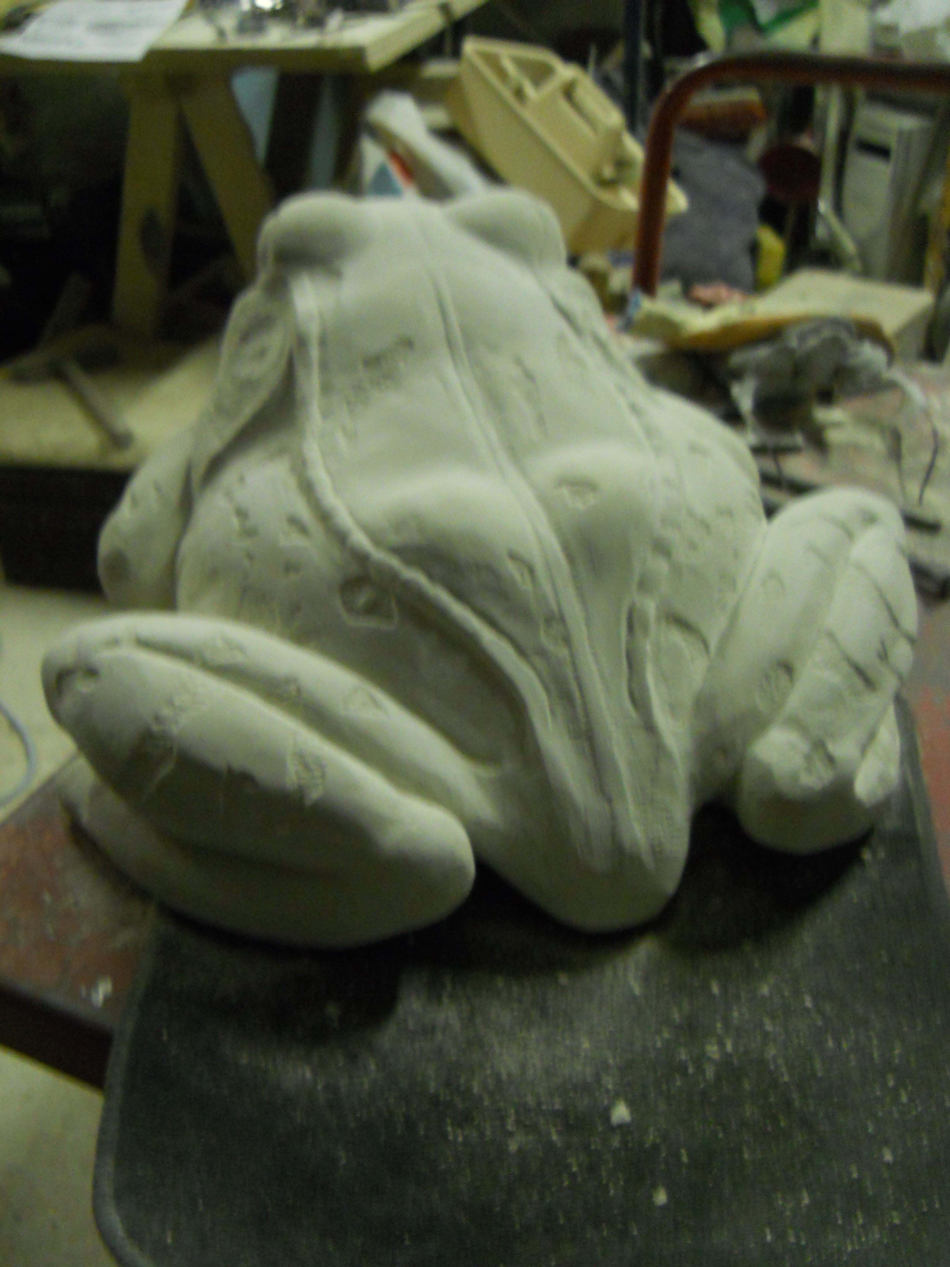 Stone carved frog