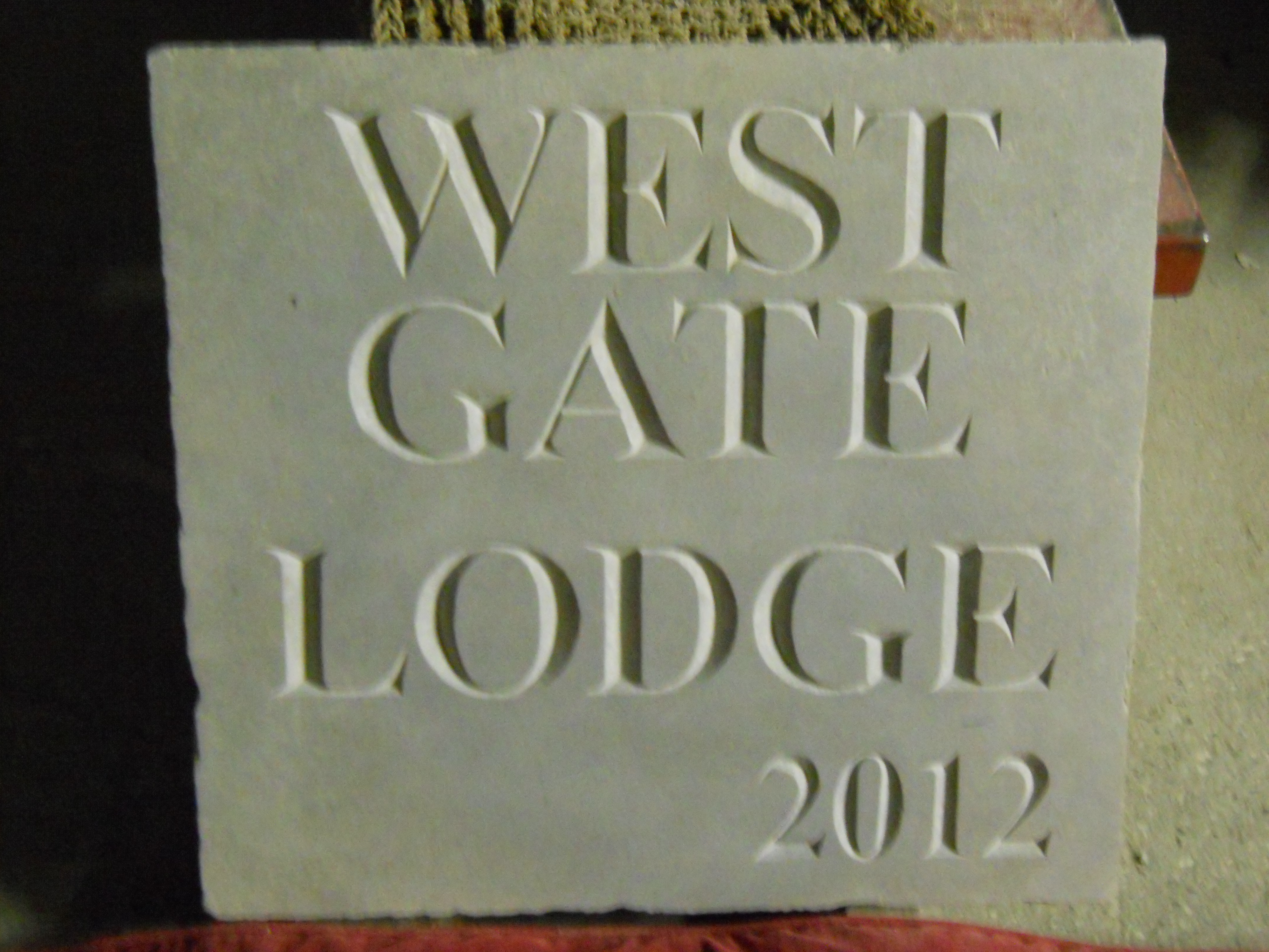 'West Gate Lodge' - carved house sign