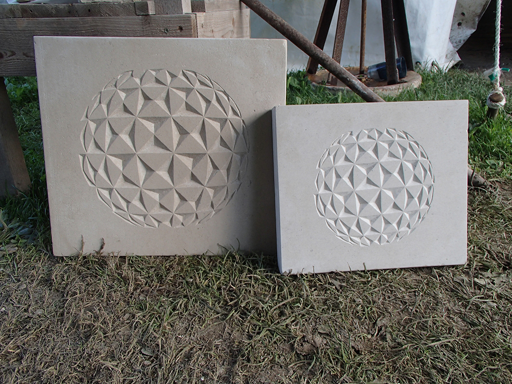 Stone carved geospheres by Jonathan Sells.