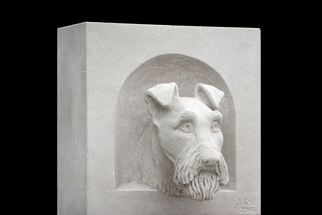 Irish Terrier, carved from Portland stone. Photo by Lindsey Harris.