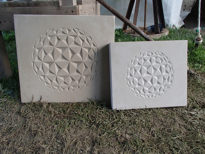 Stone carved geospheres for sale in two different sizes.