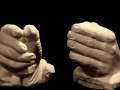 Stone carved hands.
