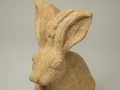 A stone hare, carved to commission by Jonathan Sells. This is a female hare carved in hamstone.