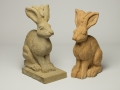Two stone hares, carved to commission by Jonathan Sells.