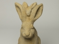 A stone hare, carved to commission by Jonathan Sells. This is a male hare carved in sandstone.