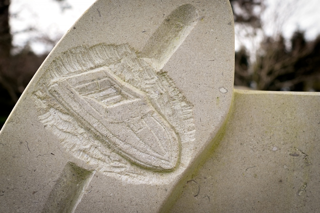 Speedboat detail from a bespoke, horseshoe-shaped headstone, carved in Portland stone for a customer.