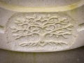 Tree of Life detail in a bespoke, horseshoe-shaped headstone, carved in Portland stone for a customer.