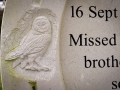 Detail of an owl from a bespoke, horseshoe-shaped headstone, carved in Portland stone for a customer.