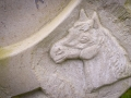 Detail of a horse's head from a bespoke, horseshoe-shaped headstone, carved in Portland stone for a customer.