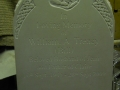 Carved headstone.
