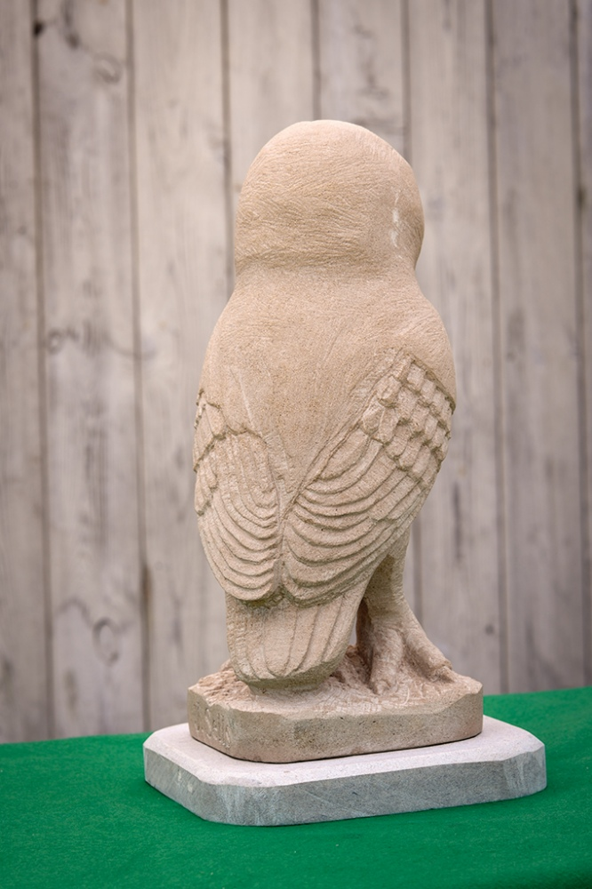 Owl, carved in Portland stone.