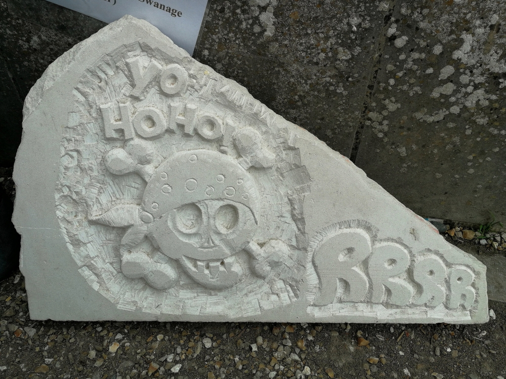 Pirate stone carving.