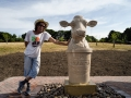 Jonathan Sells with his Purbeck stone cow fountain. Photo © Lindsey Harris.