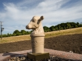 Purbeck stone cow fountain, carved by Jonathan Sells. Photo © Lindsey Harris.