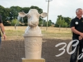 The owners and staff at Purbeck Ice Cream with Jonathan\'s Purbeck stone cow fountain.
