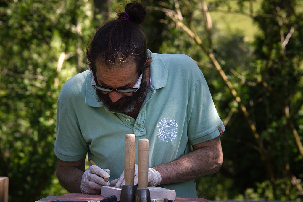 Stone carving lessons at Corfe Castle, Dorset.