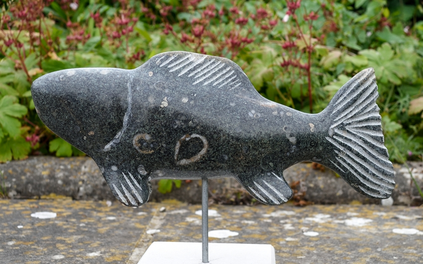 Stone fish carved by Jonathan Sells. At the 2018 Swanage Fish Festival.