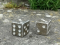 Purbeck Marble dice carved by Jonathan Sells.