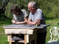 Jonathan Sells helping a student  to carve slate at Corfe Castle, Dorset.