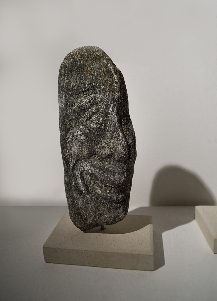 Face, carved from a large pebble (stone unknown) by Jonathan Sells. £200.