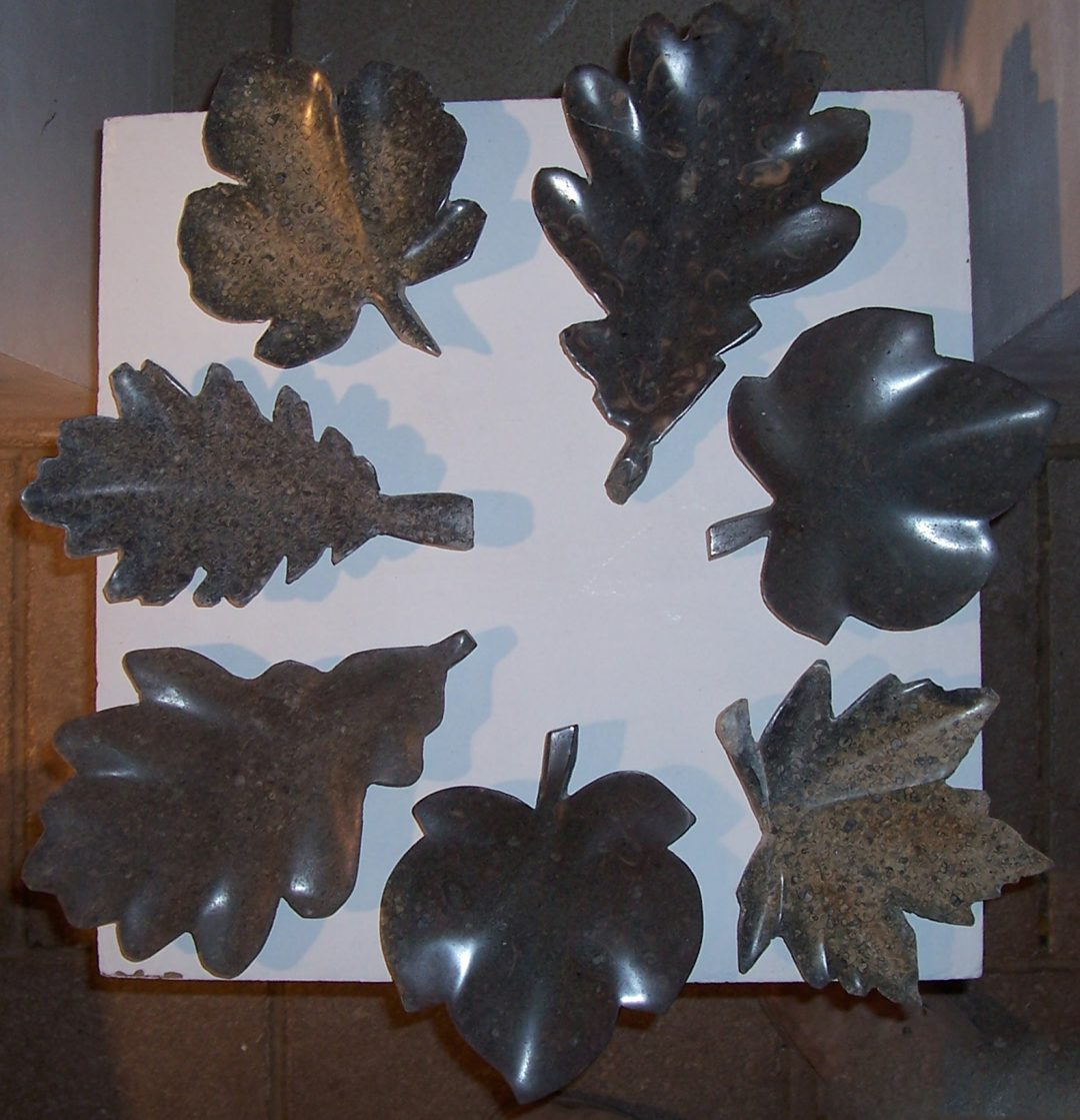 Hand carved stone leaves.