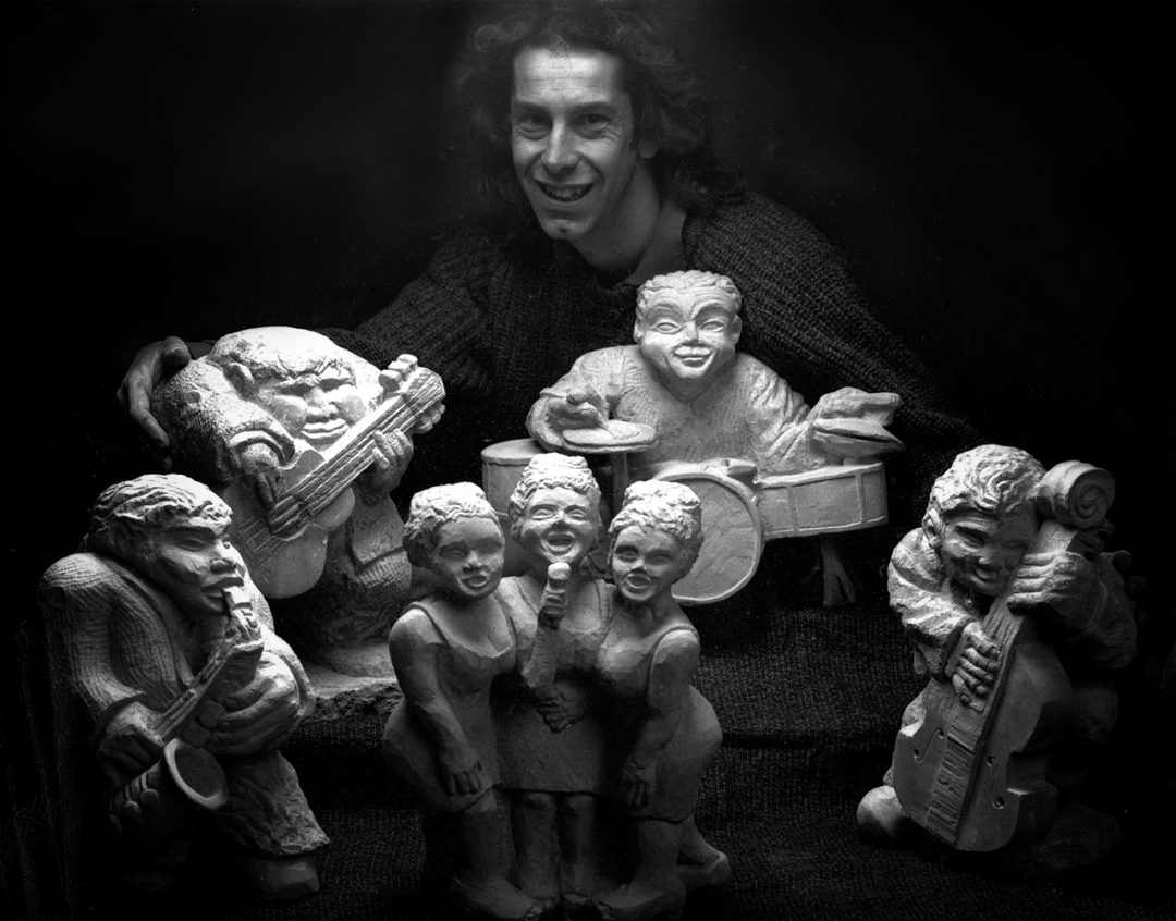 Jonathan with his 'Rock' band' and 'Backing Group' stone carvings.