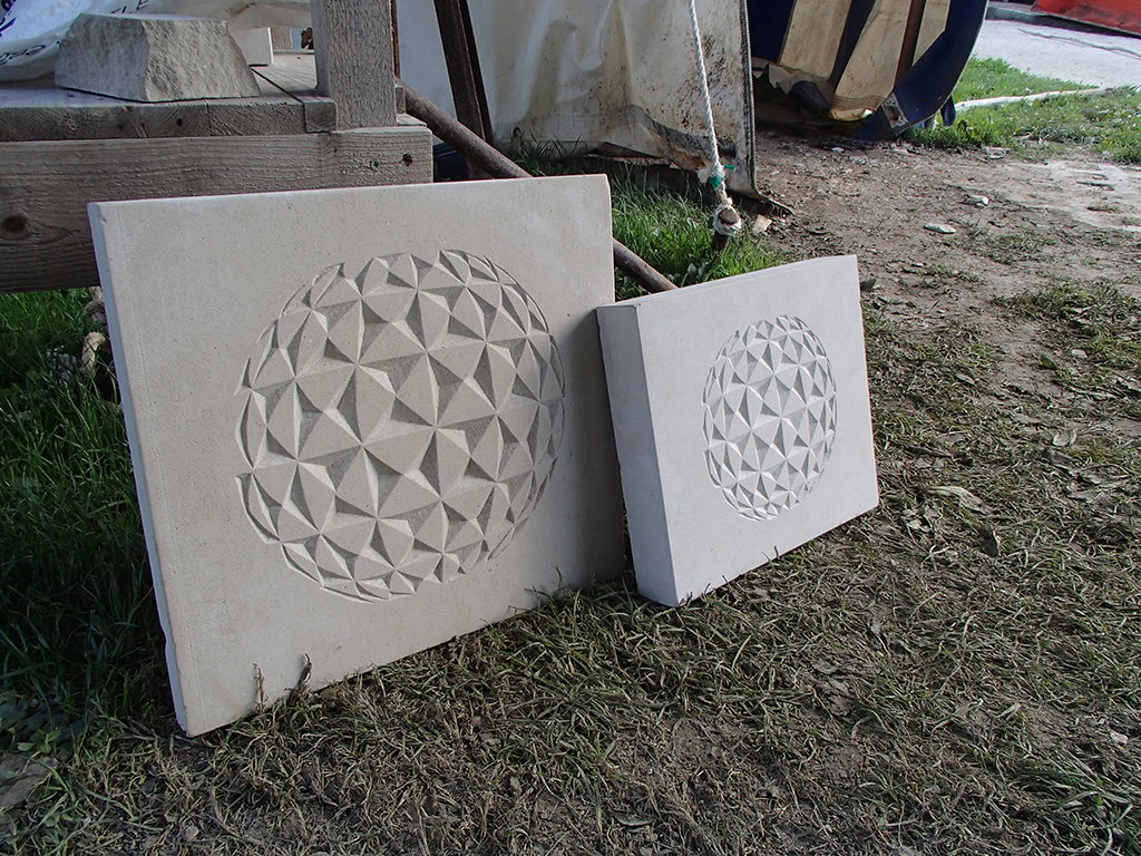 Stone carved geospheres.