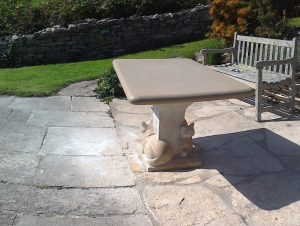 Stone carved cat table by Jonathan Sells, Dorset.