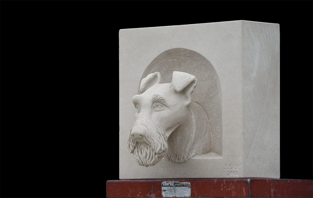 Irish Terrier carved in stone.