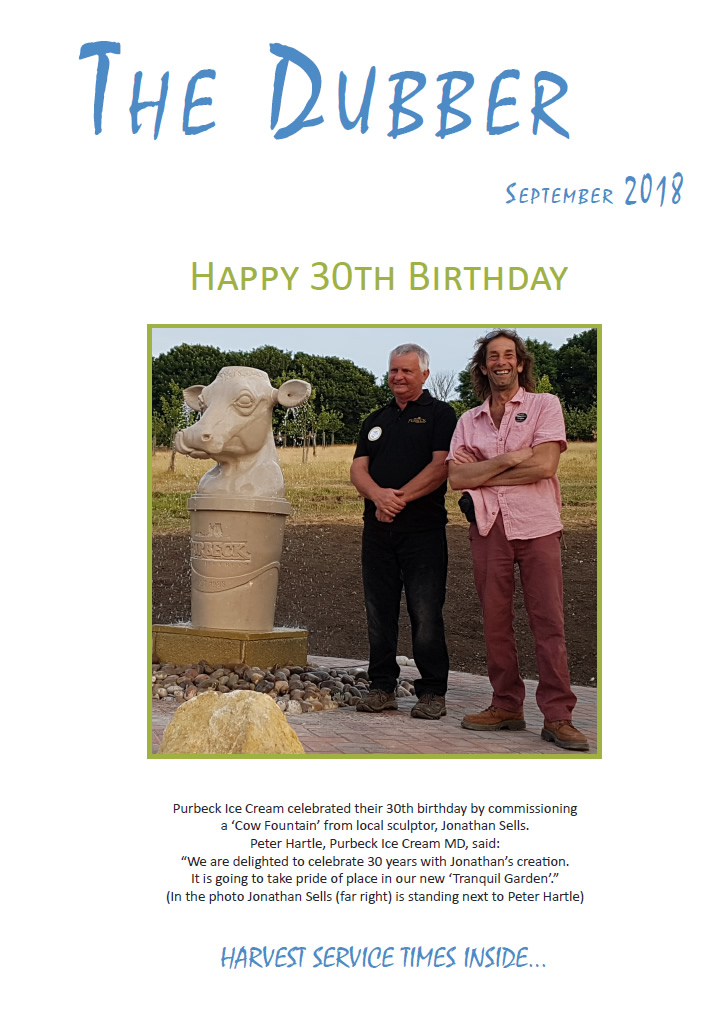 Photo of Jonathan's Purbeck stone cow fountain on the cover of September 2018's issue of 'The Dubber'. Jonathan Sells is standing on the right of Peter Hartle, MD of Purbeck Ice Cream.