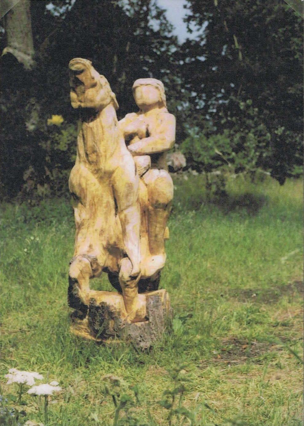 Lady on horse, carved in wood