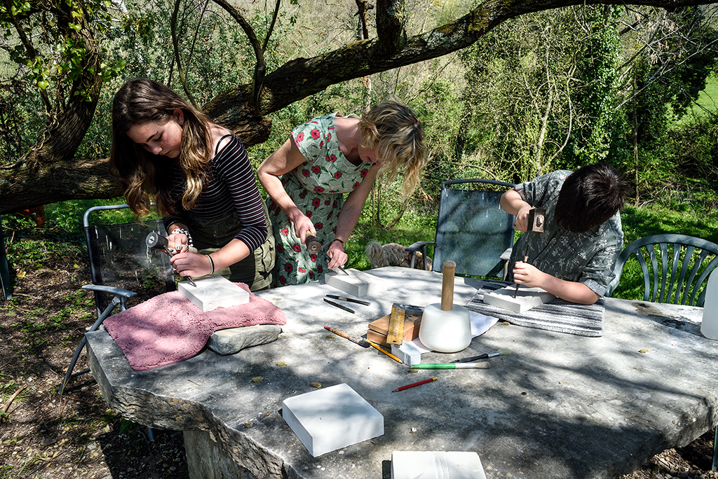 Students taking part in stone carving lessons at Sandy Hill Studios, Corfe Castle.