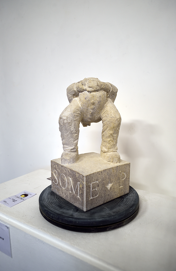 'Some People'. Carved in Purbeck stone by Jonathan Sells. For sale - £800.