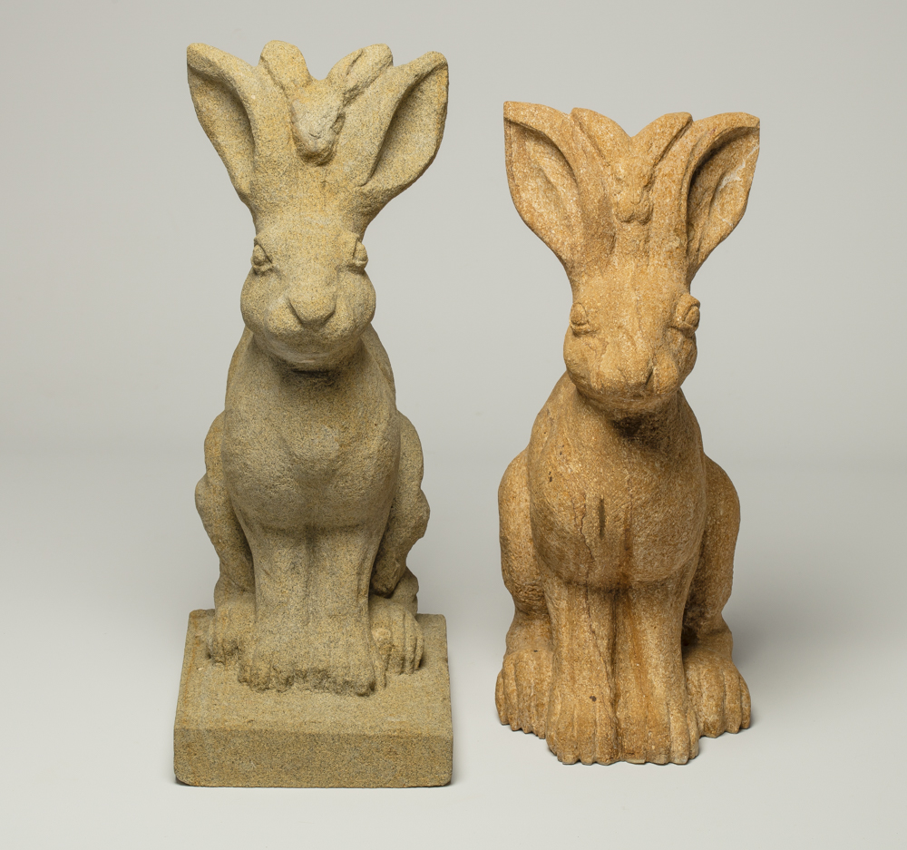 Two stone carved hares.